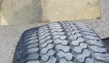 Tire tread bulge before a blowout.